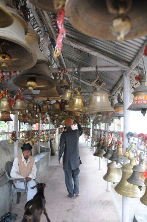 The corridor of bells begins. Big, small, huge -- depending on the size of the believer's pocket -- the temple has them all.