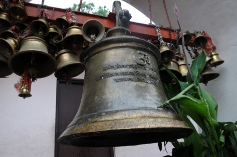 This bell has the distinction of being the biggest in the temple. It is big, believe me, I couldn't make it move, and they say I am very strong.